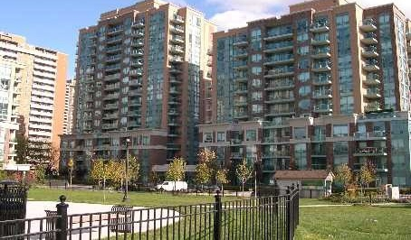 Condo for rent at 11 Michael Power Pl, Etobicoke, ON. This is the outdoor building with lawn.