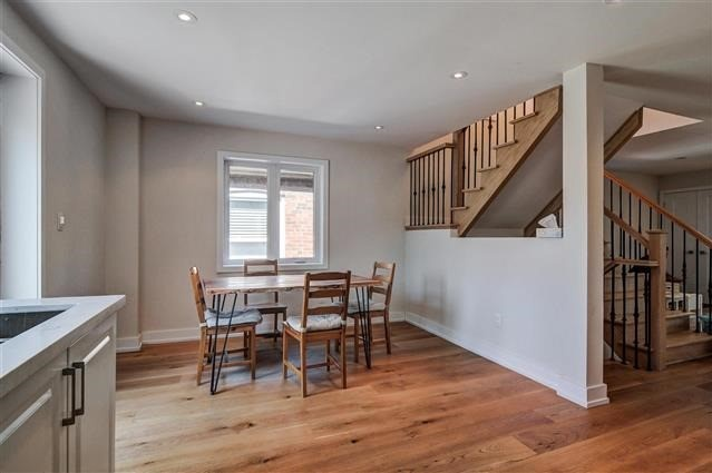 House for rent at 64 Superior Ave, Etobicoke, ON. This is the dining area with hardwood floor and natural light.