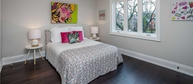 House for rent at 25 Burnhamthorpe Park Blvd, Etobicoke, ON. This is the bedroom with natural light and hardwood floor.
