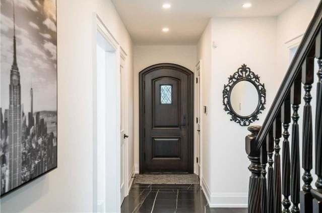 House for rent at 25 Burnhamthorpe Park Blvd, Etobicoke, ON. This is the foyer entrance with tile floor.