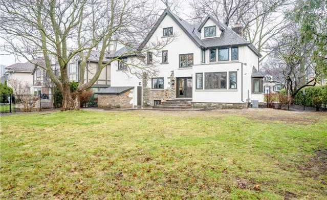 House for rent at 25 Burnhamthorpe Park Blvd, Etobicoke, ON in tudor style. This is the front of the house with lawn.