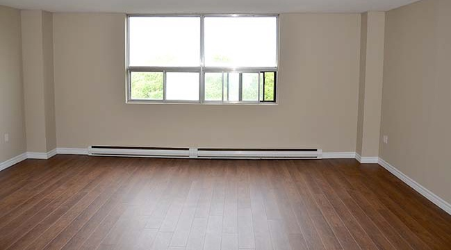 Not Sure for rent at 1030 South Park Street, Halifax, NS. This is the empty room with natural light and hardwood floor.