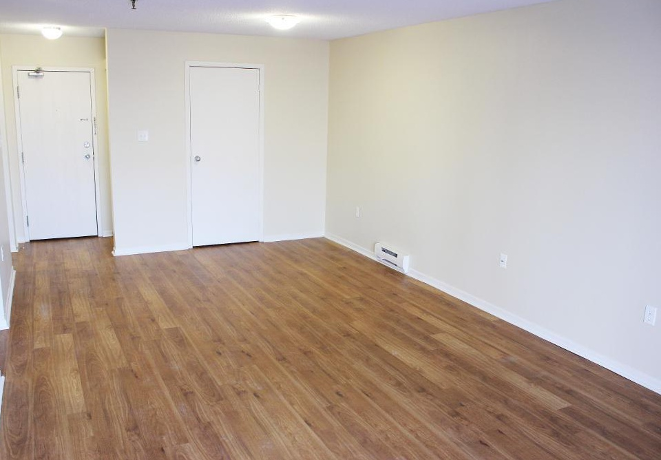Apartment for rent at 96 Highfield Park Drive, Halifax, NS. This is the empty room with hardwood floor.