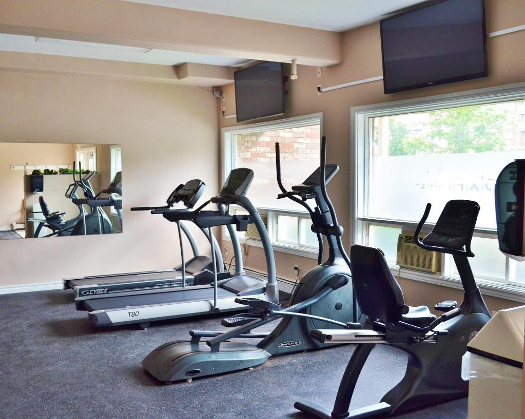 Apartment for rent at 96 Highfield Park Drive, Halifax, NS. This is the gym with beamed ceiling and carpet.