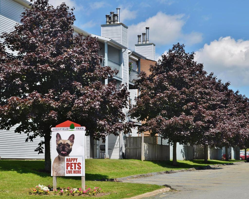Apartment for rent at 96 Highfield Park Drive, Halifax, NS. This is the outdoor building with lawn.