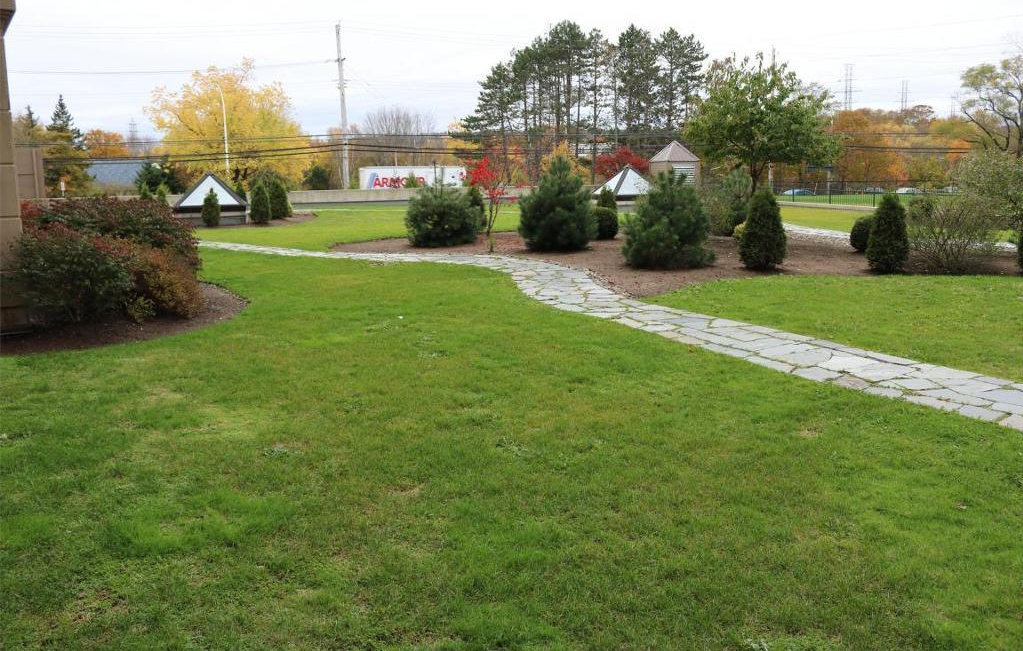 Apartment for rent at 3330 Barnstead Lane, Halifax, NS. This is the backyard with lawn.