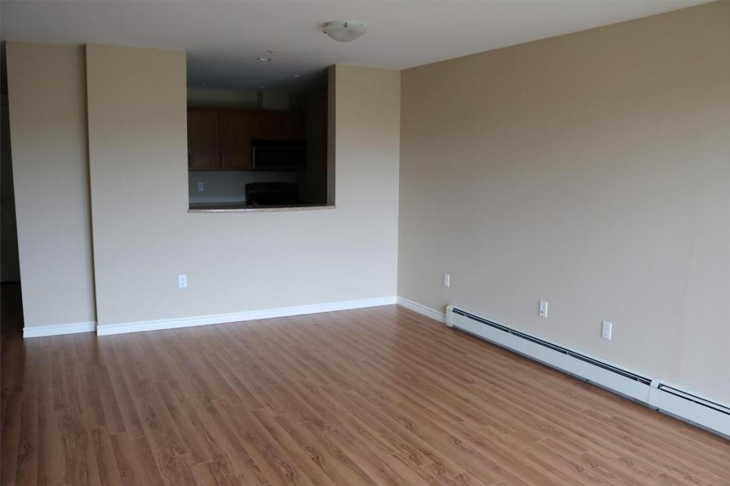 Apartment for rent at 3330 Barnstead Lane, Halifax, NS. This is the empty room with hardwood floor.