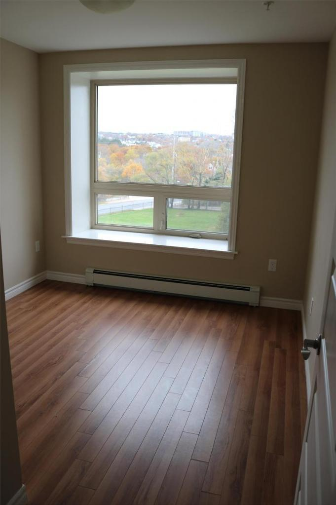 Apartment for rent at 3330 Barnstead Lane, Halifax, NS. This is the empty room with hardwood floor and natural light.