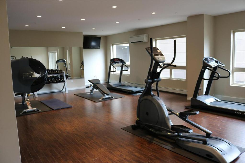 Apartment for rent at 3330 Barnstead Lane, Halifax, NS. This is the gym with hardwood floor and natural light.