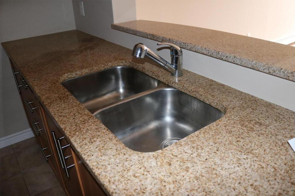Apartment for rent at 3330 Barnstead Lane, Halifax, NS. This is the kitchen with tile floor.