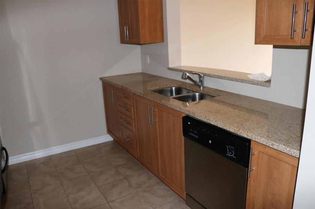 Apartment for rent at 3330 Barnstead Lane, Halifax, NS. This is the kitchen with tile floor and stainless steel.