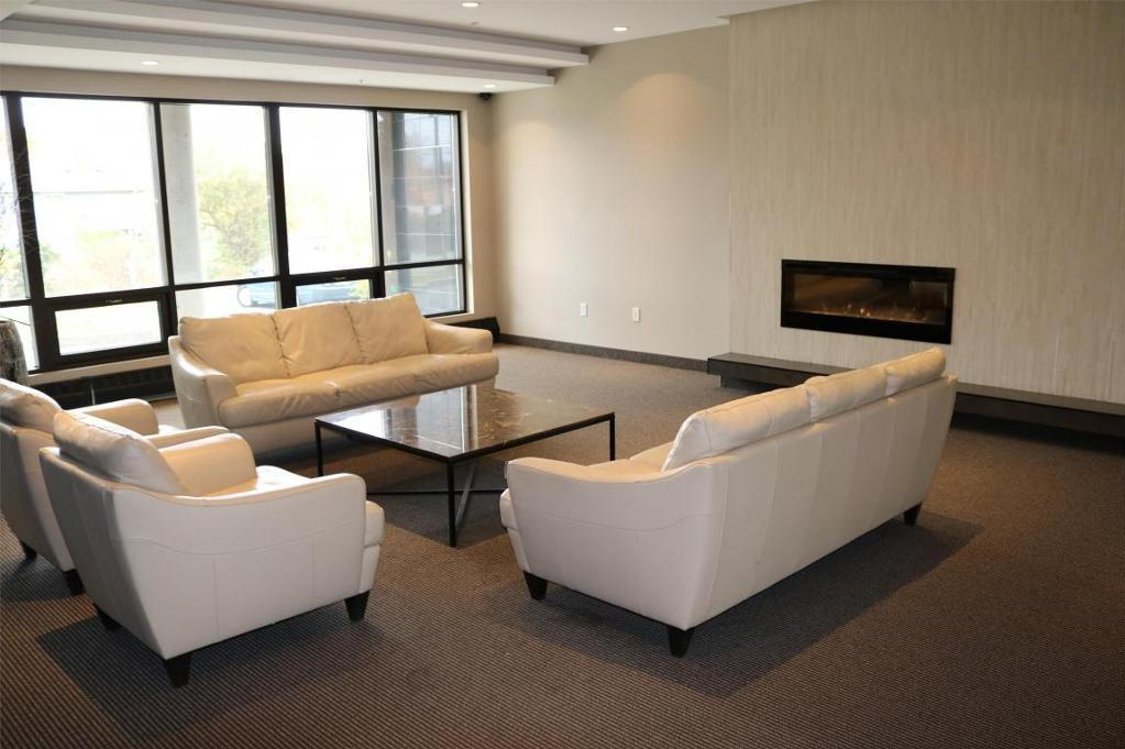 Apartment for rent at 3330 Barnstead Lane, Halifax, NS. This is the living room with carpet, fireplace and natural light.