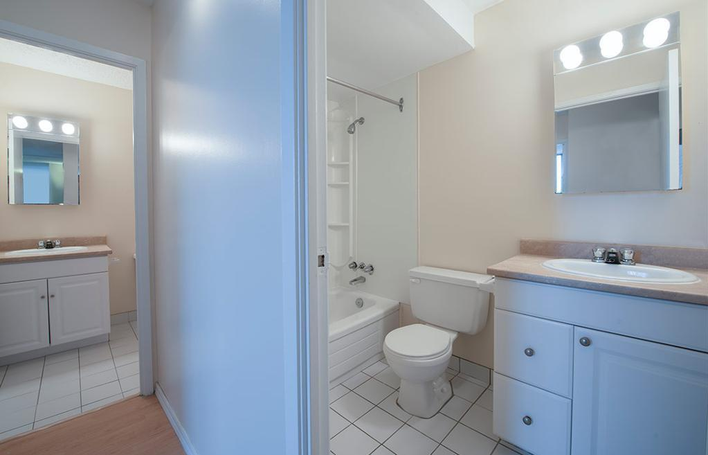 Apartment for rent at 5415 Victoria Road, Halifax, NS. This is the bathroom with tile floor and hardwood floor.