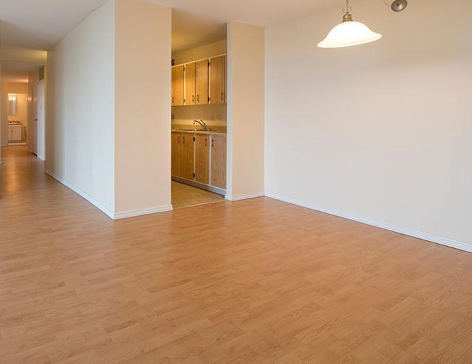 Apartment for rent at 5415 Victoria Road, Halifax, NS. This is the empty room with hardwood floor.
