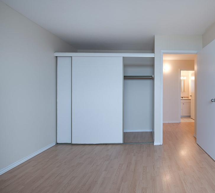 Apartment for rent at 5415 Victoria Road, Halifax, NS. This is the empty room with vaulted ceiling and hardwood floor.
