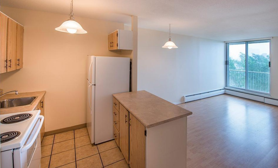 Apartment for rent at 5415 Victoria Road, Halifax, NS. This is the kitchen with hardwood floor, kitchen island and natural light.
