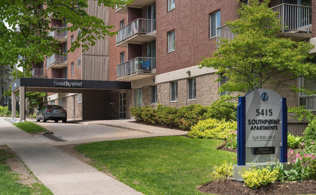 Apartment for rent at 5415 Victoria Road, Halifax, NS. This is the outdoor building with lawn.