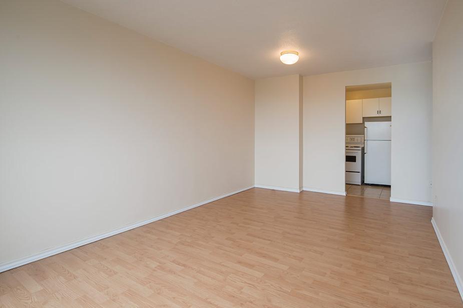 Apartment for rent at 5651 Ogilvie Street, Halifax, NS. This is the empty room with hardwood floor.