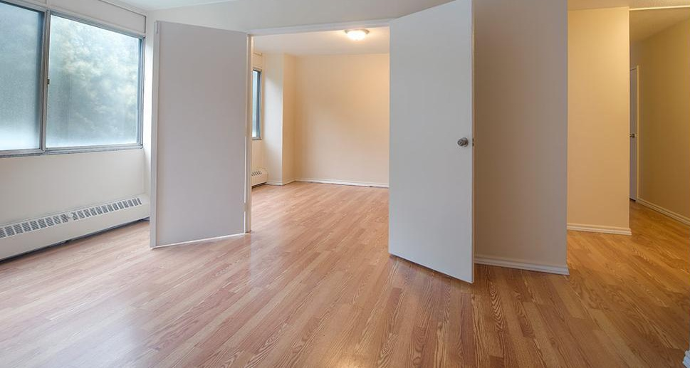 Apartment for rent at 5651 Ogilvie Street, Halifax, NS. This is the empty room with natural light and hardwood floor.