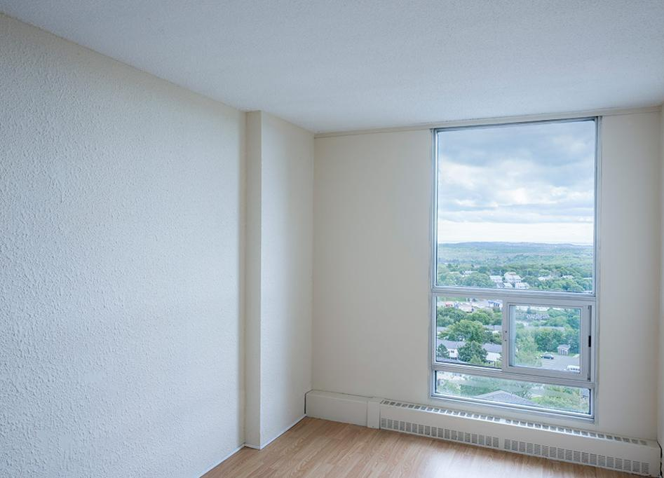 Apartment for rent at 36 Abbey Road, Halifax, NS. This is the empty room with natural light and hardwood floor.
