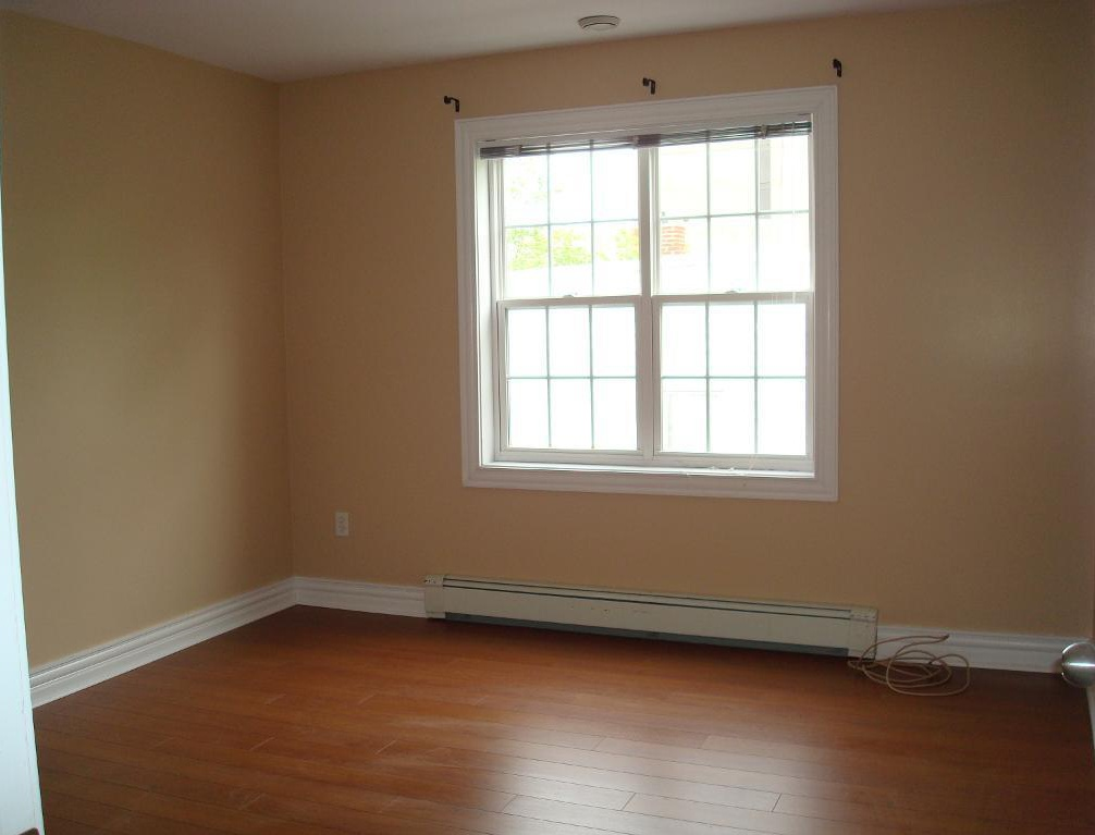 House for rent at 6057 Pepperell Street, Halifax, NS. This is the empty room with hardwood floor and natural light.