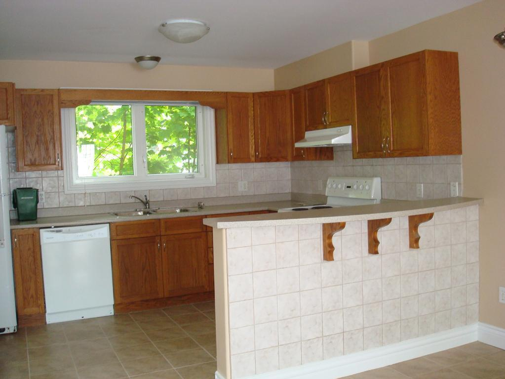House for rent at 6057 Pepperell Street, Halifax, NS. This is the kitchen with tile floor and natural light.
