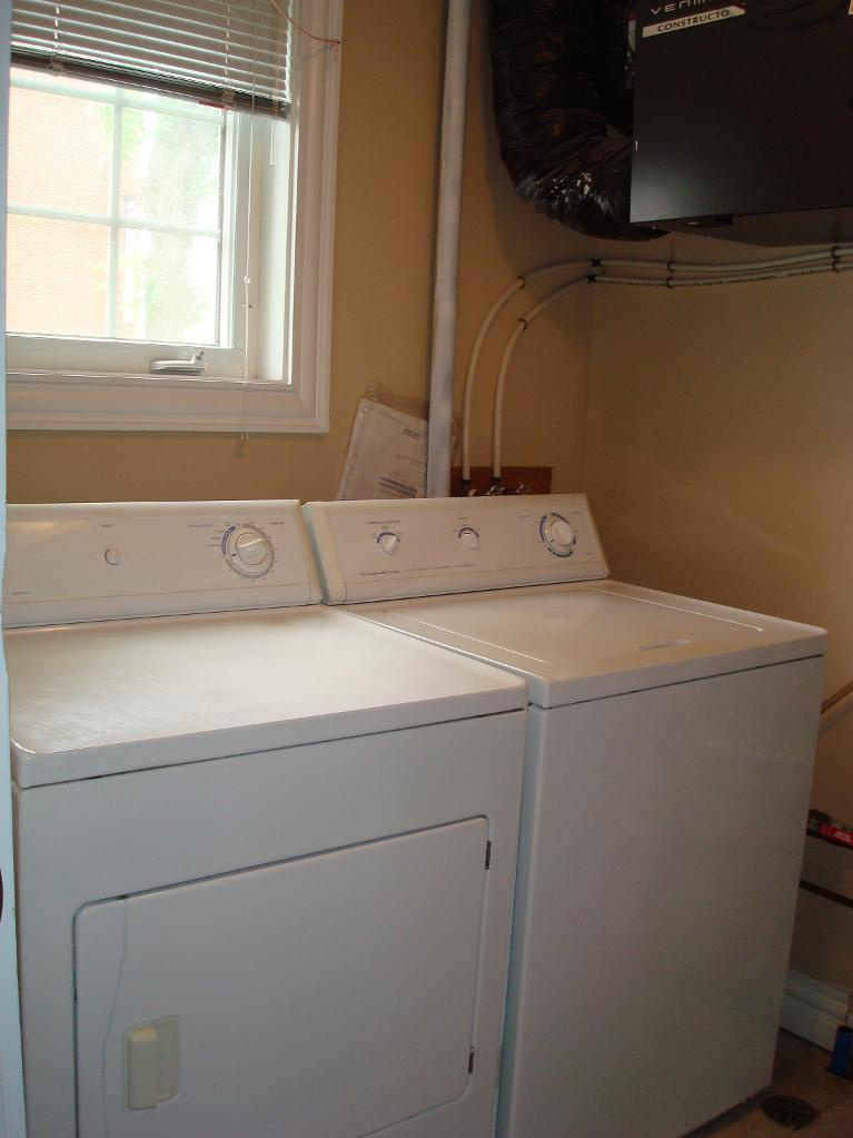 House for rent at 6057 Pepperell Street, Halifax, NS. This is the laundry room with natural light.