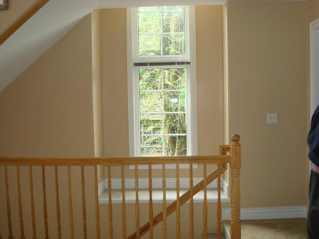 House for rent at 6057 Pepperell Street, Halifax, NS. This is the stairs with tile floor and natural light.