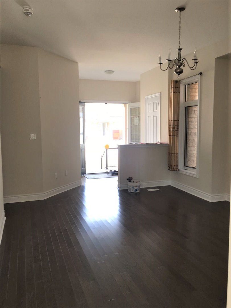 House for rent at 92 Morningside Dr, Halton Hills, ON. This is the empty room with hardwood floor, notable chandelier and natural light.