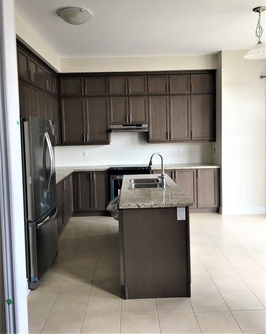 House for rent at 92 Morningside Dr, Halton Hills, ON. This is the kitchen with tile floor, kitchen island and stainless steel.