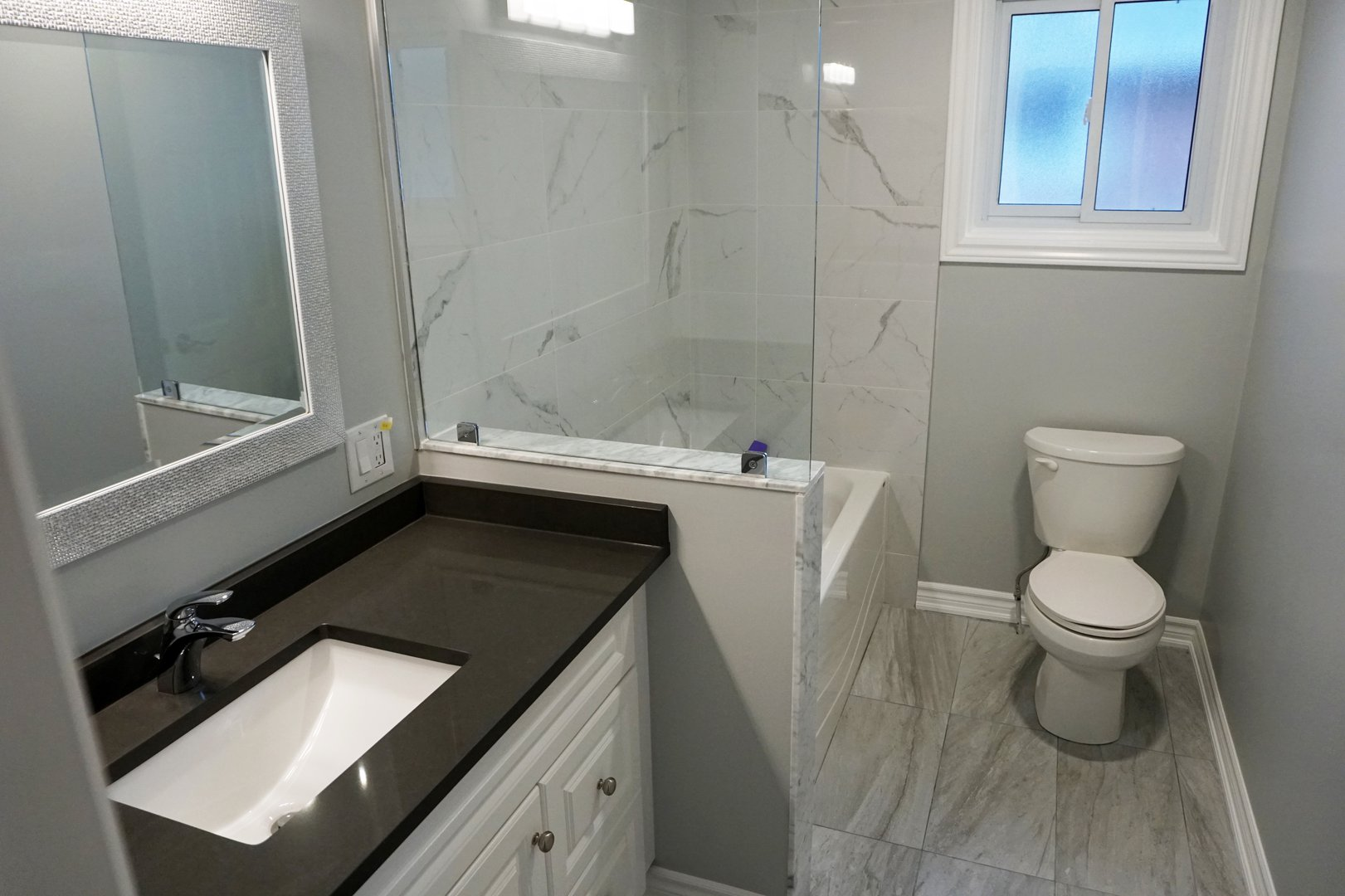 Apartment for rent at 89 David Ave, Hamilton, ON. This is the bathroom with tile floor and natural light.