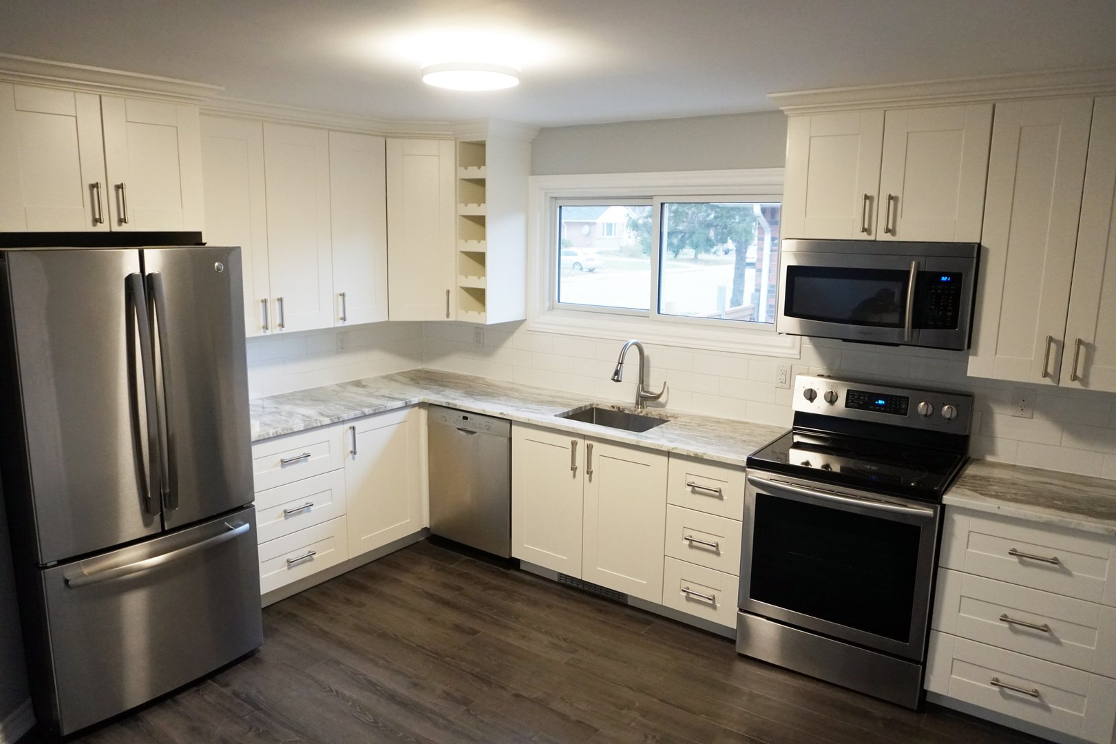 Apartment for rent at 89 David Ave, Hamilton, ON. This is the kitchen with hardwood floor, stainless steel and natural light.