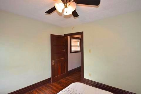 Apartment for rent at 17 Gladstone Ave, Hamilton, ON. This is the bedroom with hardwood floor and ceiling fan.
