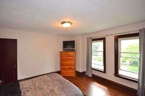 Apartment for rent at 17 Gladstone Ave, Hamilton, ON. This is the bedroom with hardwood floor and natural light.