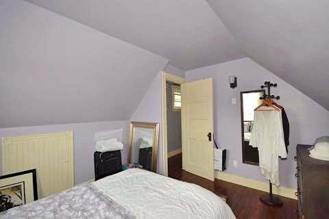 Apartment for rent at 17 Gladstone Ave, Hamilton, ON. This is the bedroom with vaulted ceiling and hardwood floor.