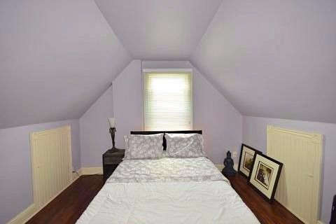 Apartment for rent at 17 Gladstone Ave, Hamilton, ON. This is the bedroom with vaulted ceiling, hardwood floor and natural light.