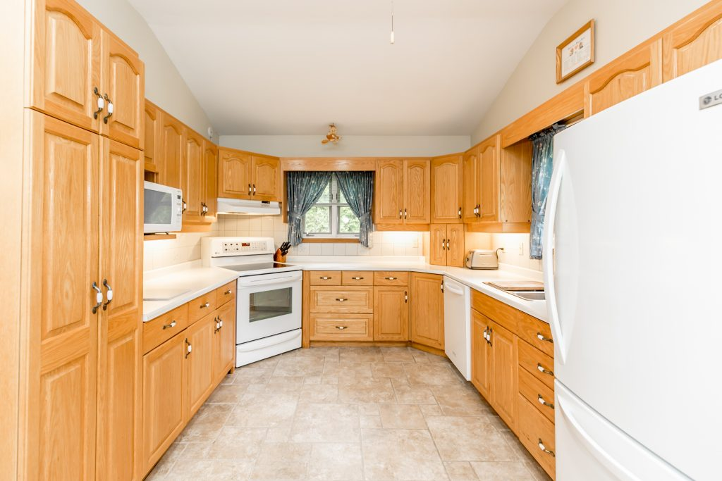 Apartment for rent at 1158 Birch Rd, Innisfil, ON. This is the kitchen with natural light, tile floor and vaulted ceiling.