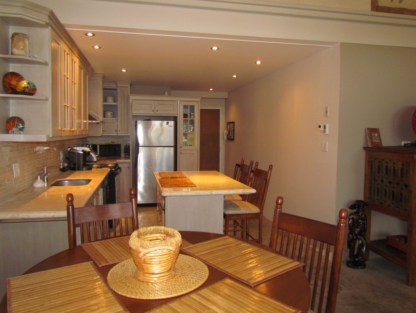 Apartment for rent at 8, Maple, Knowlton, QC. This is the kitchen with kitchen island, stainless steel, kitchen bar and carpet.