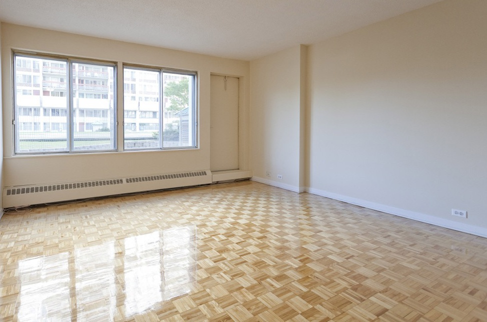 Not Sure for rent at 1 Place De La Belle-Rive, Laval, QC. This is the empty room with natural light and tile floor.
