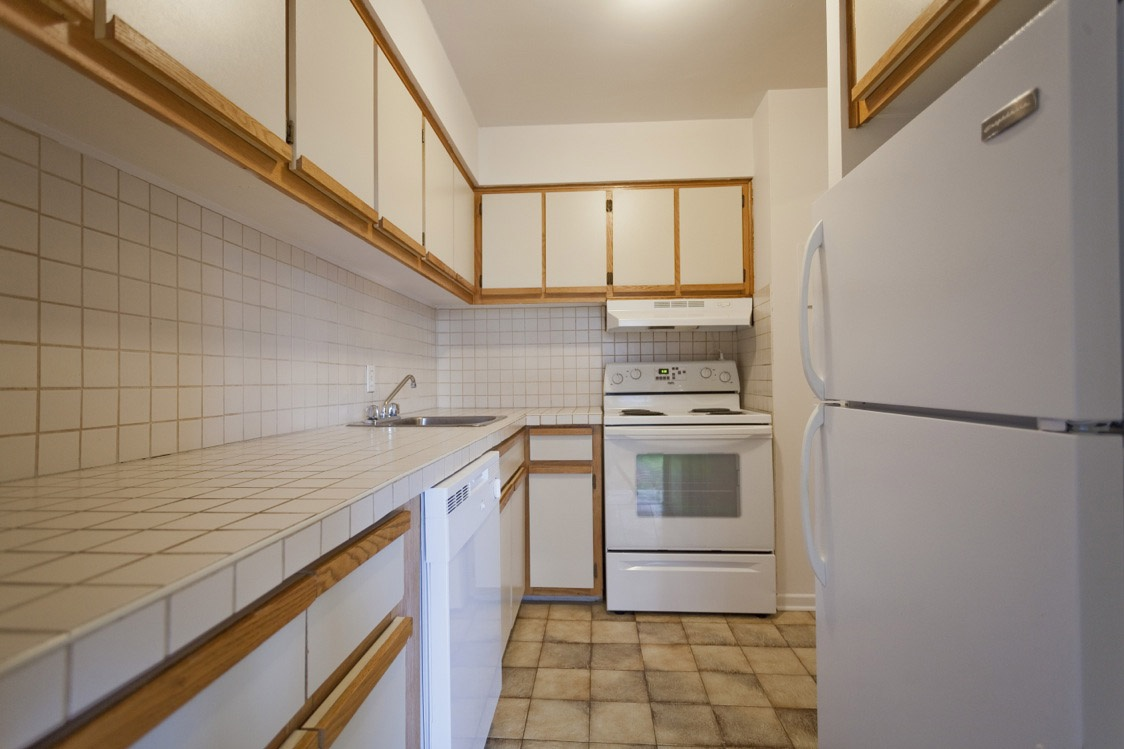 Not Sure for rent at 1 Place De La Belle-Rive, Laval, QC. This is the kitchen with tile floor.