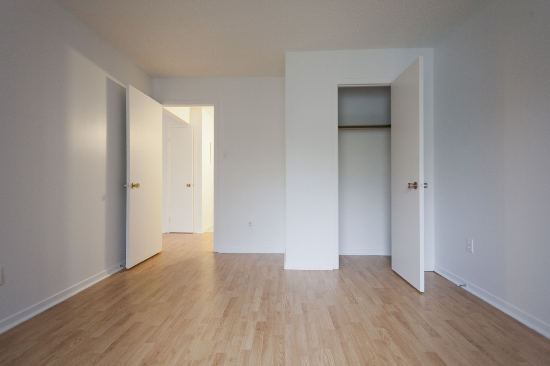 Apartment for rent at 2507 Montarville Street, Longueuil, QC. This is the empty room with hardwood floor.