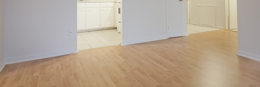 Apartment for rent at 2507 Montarville Street, Longueuil, QC. This is the empty room with tile floor and hardwood floor.