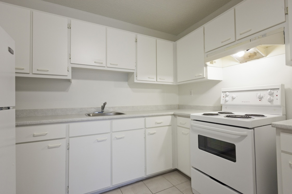 Apartment for rent at 2507 Montarville Street, Longueuil, QC. This is the kitchen with tile floor.