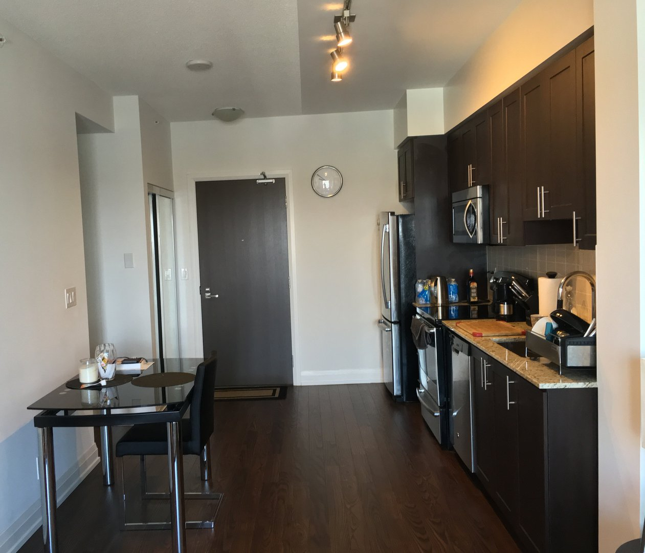 Condo for rent at 7161 Yonge Street, Markham, ON. This is the kitchen with hardwood floor.