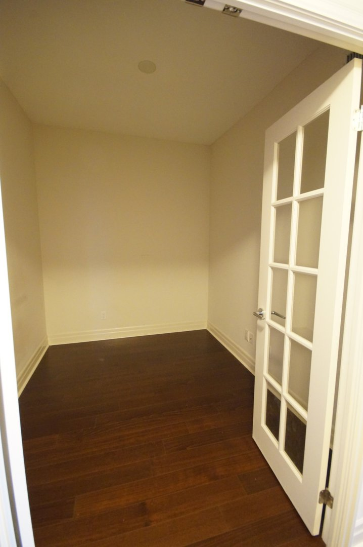 Condo for rent at 8130 Birchmount Rd, Markham, ON. This is the empty room with hardwood floor.