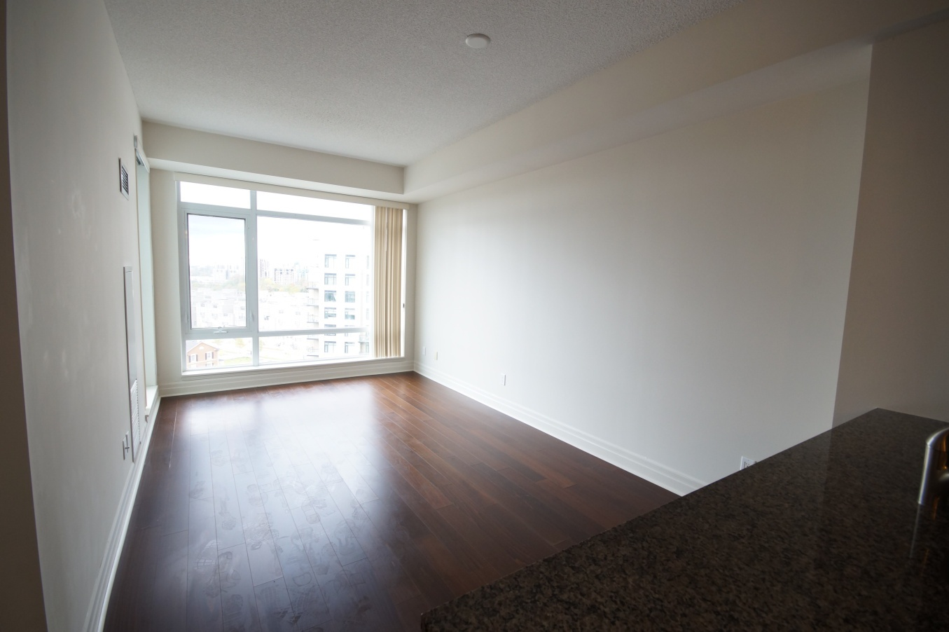 Condo for rent at 8130 Birchmount Rd, Markham, ON. This is the empty room with natural light and hardwood floor.