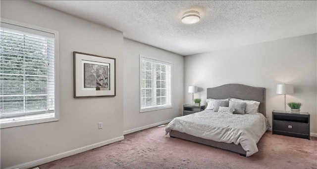 Townhouse for rent at 21 Interlacken Way, Markham, ON. This is the bedroom with natural light and carpet.