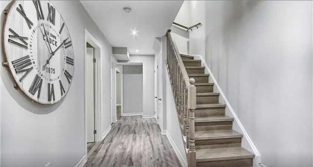 Townhouse for rent at 21 Interlacken Way, Markham, ON. This is the foyer entrance with hardwood floor.