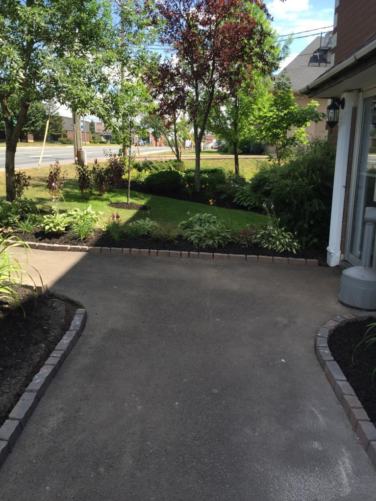 Apartment for rent at 1700 Mountain Road, Moncton, NB. This is the backyard with lawn.