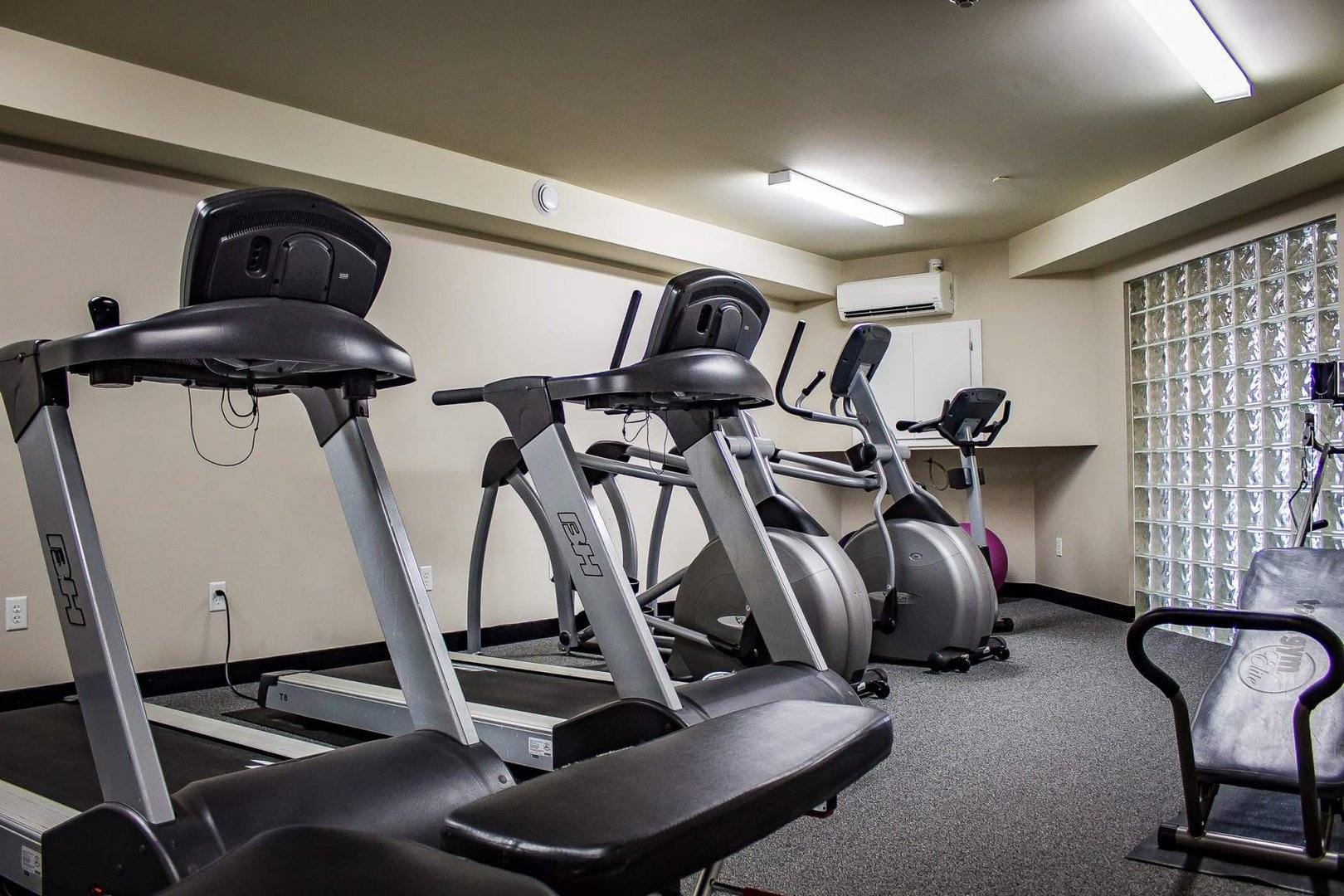 Mid-Rise-Apartment for rent at 747 Coverdale Road, Moncton, NB. This is the gym with carpet.
